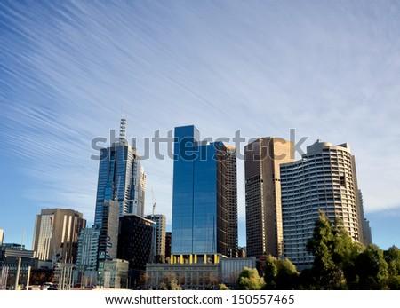 melbourne skyline with interesting streaky sky - stock photo