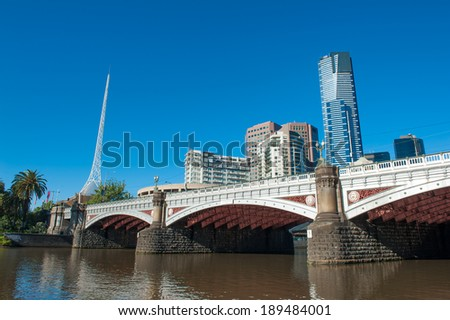 Melbourne skyline with skyscrapers and famous  Melbourne Arts Centre Spire seen across the river Yarra. Victoria, Australia - stock photo