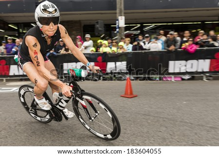 MELBOURNE, VICTORIA, AUSTRALIA - MARCH 23, 2014 - Mary Beth Ellis of USA during the 180km Ironman bike leg on March 23, 2014. - stock photo
