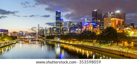 Melburne City, Yarra River with Reflection Cityscape Skyline background under dramatic Golden Sky Sunset at Dusk Twilight, Australia