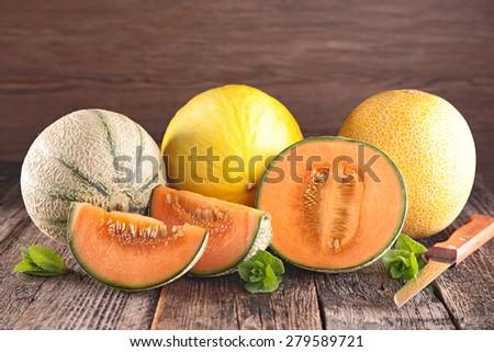 melon on wood background - stock photo