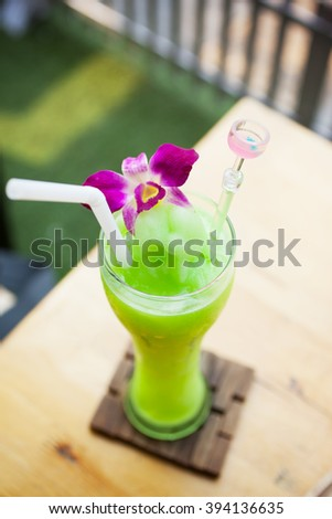 melon smoothie with orchid decorated - stock photo