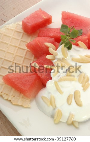melon with cream fresh and almond slivers and wafer
