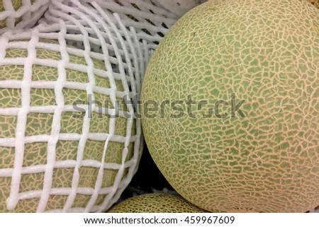 Melon with Foam mesh in the market, Top view. Selective and soft focus.