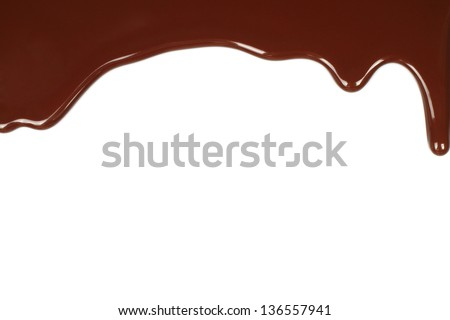 Melted chocolate dripping on white background - stock photo