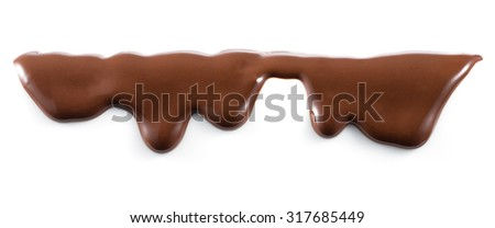 Melted chocolate is dripping. Streams isolated on white. - stock photo