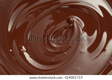 Melted chocolate swirl with a hazelnut/ melting chocolate/ chocolate swirl - stock photo