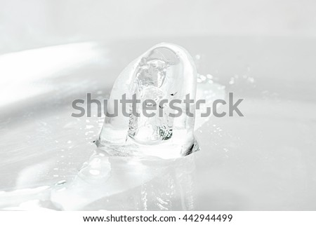 Melted ice cubes on the table - stock photo