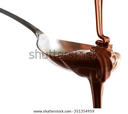 Melted milk chocolate pouring from a spoon, isolated on white - stock photo