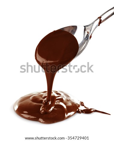 Melted milky brown chocolate pouring from a spoon, isolated on white - stock photo