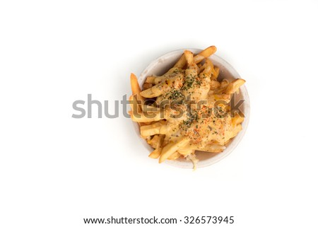 Melted mozzarella cheese, cheddar cheese and provolone on french fries with paprika,oregano and parsley flakes isolated on white background.  - stock photo