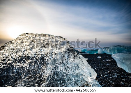 Melting glacier ice at Jokulsarlon lake Iceberg landscape Iceland at Joulsarlon glacier lagoon drifting pack ice melting caused by global warming beautiful arctic travel and tourism location cold - stock photo