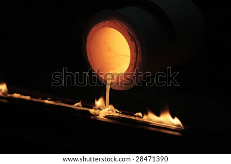 melting gold dripping, production - stock photo