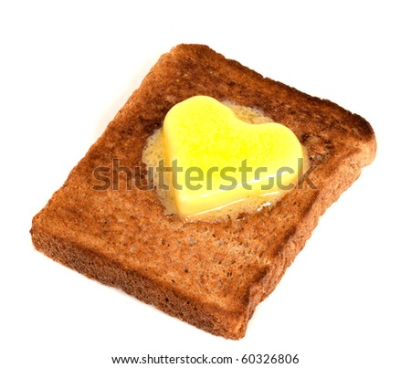 Melting Heart Shaped Butter on wholemeal Toast on white background - stock photo