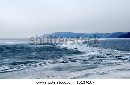 Melting ice at the Baikal lake in winter