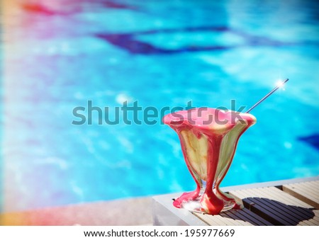 Melting ice cream on a table near pool - stock photo