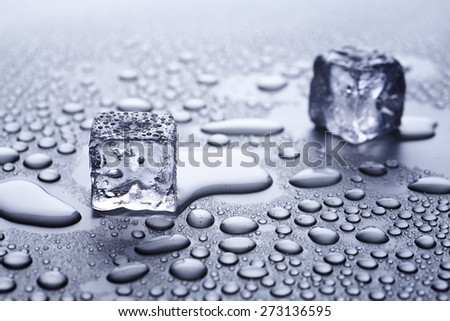 melting ice cubes and water drops  - stock photo