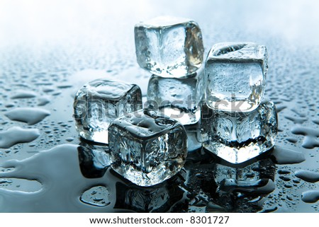 Melting ice cubes on reflective background