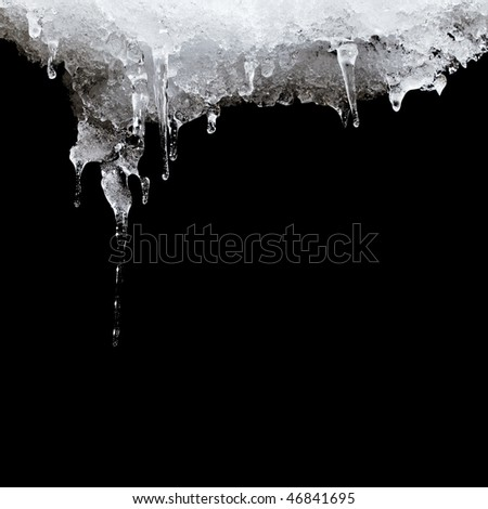 melting ice hanging from the roof. isolated on black - stock photo