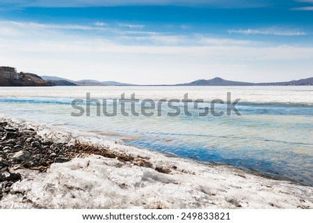 Melting ice on the lake. Beautiful spring landscape