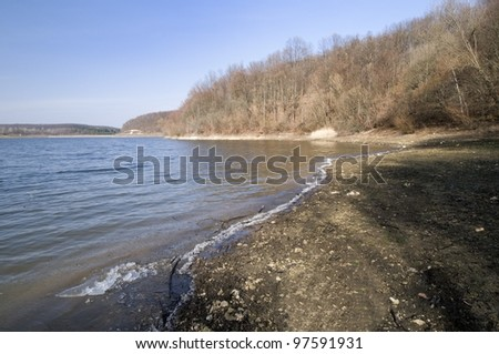 Melting of ice on the lake announce the start of spring - stock photo