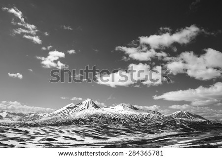 Melting snow in high elevation mountains of Canada in spring in black and white. - stock photo