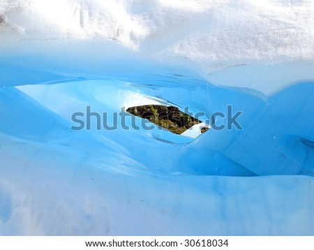 Melting Tunnel of Ice on Fox Glacier, New Zealand - stock photo