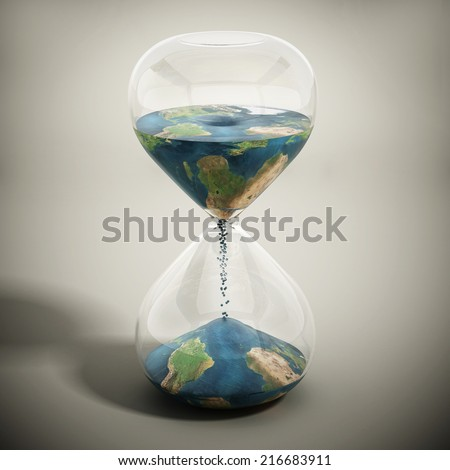 Melting world concept with earth textured sand pouring inside the hourglass.  Image includes elements furnished by NASA. - stock photo