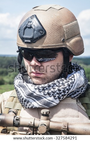 Member of Navy SEAL Team with weapons in action