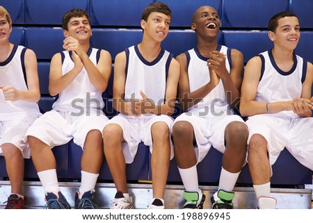 Members Of Male High School Basketball Team Watching Match - stock photo