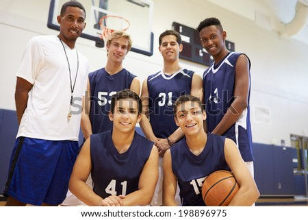 Members Of Male High School Basketball Team With Coach - stock photo