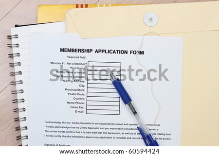 Membership application form with envelopes and spiral notebook