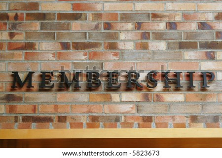 Membership Sign on Brick Wall - stock photo