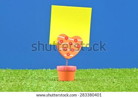 memo holder with yellow memo paper - stock photo