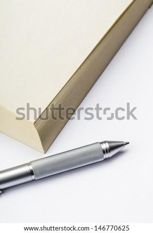 Memo pad and pen - stock photo