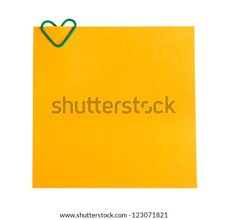 memo paper and clip in the form of heart - stock photo