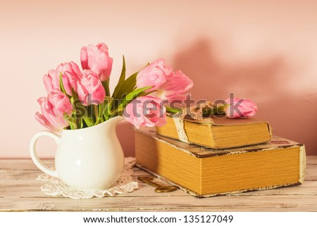 Memo still life with books, key and pink tulips - stock photo