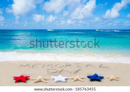 Memorial day background on the sandy beach near ocean - stock photo