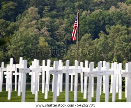 Memorial Day display of crosses and United States flag. - stock photo