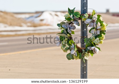 Memorial Wreath of Flowers for Someone who Died in a Car Accident - stock photo