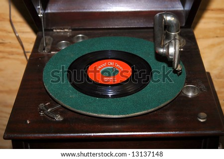 "Memories and memorabilia are reflected in the label of this record on an old fashioned record player. Photographer added ""Good old Days by Memory Lane"" to add to the nostalgia."