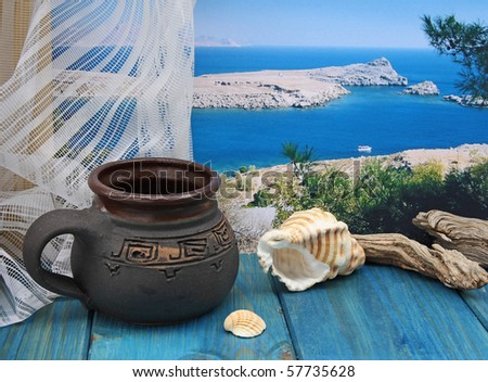 Memories of Rhodos island, still life with cup and photo coast of Rhodes on background - stock photo