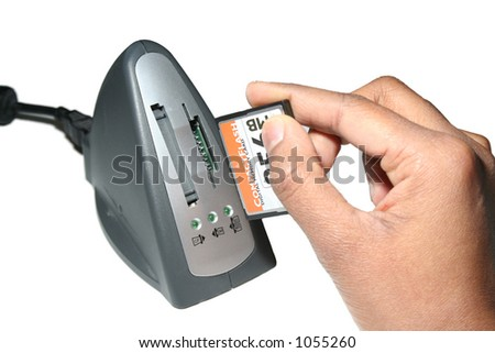 Memory card being placed into reader - stock photo