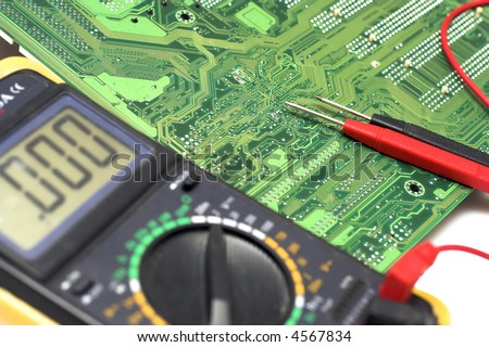 Memory Circuit Board Close Up with multimeter - stock photo