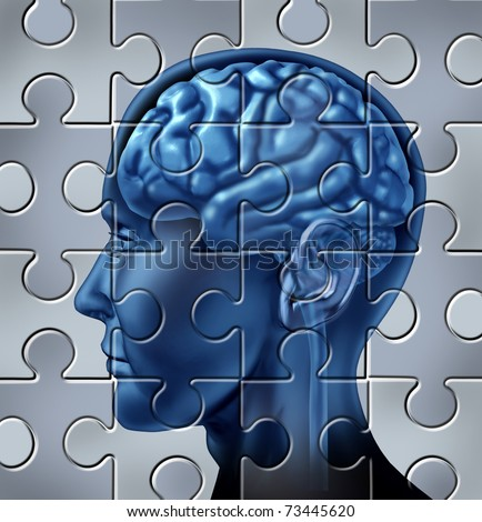Memory loss and alzheimer's mental health symbol represented by a human brain with a puzzle texture. - stock photo