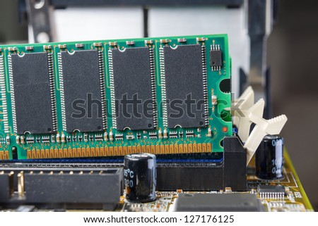 Memory module in a PC is being removed from the slot on the mother board.