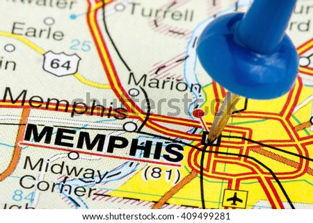 Memphis Tennessee highlighted with blue push pin on atlas or map closeup - stock photo