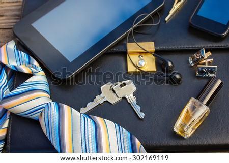 Men accessories: tie, cufflinks, tablet, perfume, keys  - stock photo
