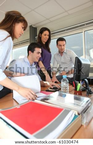Men and businesswomen in office - stock photo