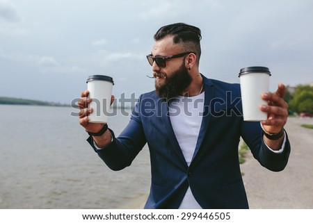 Men and coffee on the beach - stock photo